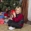 Portrait of a smiling boy holding his christmas gift — Stock Photo #17436493