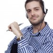 Portrait of a young call center operator with headset - Stock Photo