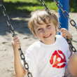 Portrait of cute boy swinging on swing — Stock Photo