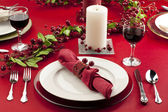 Lighted candle on the dinner table — Stock Photo