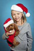 Little girl holding a puppy — Stock Photo