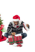 Man unwrapping gift — Stock Photo