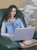 Smiling teen on laptop — Stock Photo