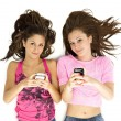 Portrait of teenage girls holding cellphone — Stock Photo