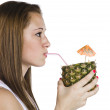 Profile view of a teenage girl drinking pineapple — Stock Photo