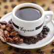 Coffee cup and coffee beans — Stock Photo #18397193