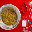 Cooking utensils with christmas objects on a red surface - Stok fotoğraf