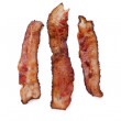 Crispy bacon on white — Stock Photo