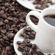 Stock Photo: Cropped image of coffee cups with beans