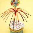 Cupcake with a birthday sign — Stock Photo