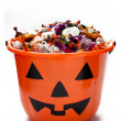 Halloween bucket with candies — Stock Photo