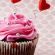 Royalty-Free Stock Photo: Image of a strawberry cupcake with heart shapes and metal beads