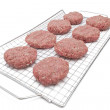 Patties on a grid — Stock Photo
