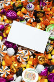 Candies with placard above it — Stockfoto