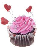 Close-up beeld van chocolade cupcake met roze slagroom en hart sh — Stockfoto