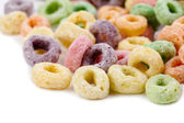 Colorful cornflakes rings on white — Stock Photo