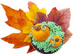 Cupcake decorated with pumpkin miniature and autumn leaves — Stock Photo