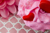 Extreme close up of strawberry cupcake with heart shapes embedde — Stock Photo