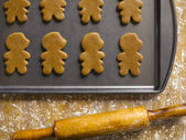 Gingerbread cookies and rolling pin — Stock Photo