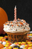 Halloween cupcake with candle — Stock Photo