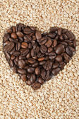 Heart shape coffee beans with cereals — Stock Photo