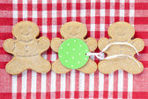 Image of gingerbread candies arranged over red checkered napkin — Stock Photo