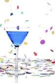 Martini glass with curacao and confetti on white — Stock Photo