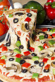 Melted supreme pizza — Stock Photo