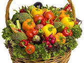 Overflowing vegetable basket — Stock Photo