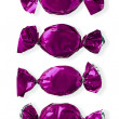 View of purple shiny candies arranged side by side — Stock Photo #18401341