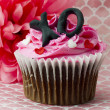 Royalty-Free Stock Photo: View of strawberry cupcake with alphabets inscribed with cream