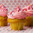 View of three strawberry cupcakes with sugar icing — Stock Photo