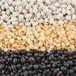 White and black beans with yellow split peas — Stock Photo