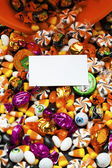 Placard with colorful candies behind it — Stock Photo