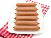 Uncooked Hotdogs on a Plate — Stock Photo