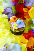 View of a cupcake with decorative miniature toppings surrounded — Stock Photo