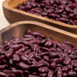 Red beans in wooden bowl — Stock Photo