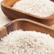 Wooden bowl of rice grains — Stock Photo