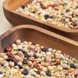 Wooden bowls full of beans and pulses — Stock Photo