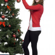 Attractive woman decorating christmas tree — Stock Photo