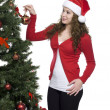 Beautiful young woman decorating christmas tree — Foto Stock