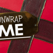 Unwrap me tag on christmas present — Stock Photo #18738463