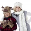 Boy and girl wearing winter clothing — Stock Photo