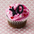 Close up shot of strawberry cupcake with heart shape and xo alph — Stock Photo