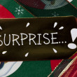 Close up image of surprise placard on gift box — Stock Photo #18738887