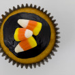 Stock Photo: Cupcake with colorful toppings