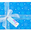 Detailed shot of a blue christmas gift box with snowman sticker - Lizenzfreies Foto