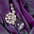 Gemstone in purple fabric — Stock Photo