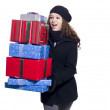 Happy young female holding stack of christmas present - Lizenzfreies Foto