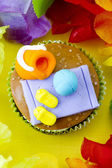 Top view of cupcake with decorative miniature — Stock Photo